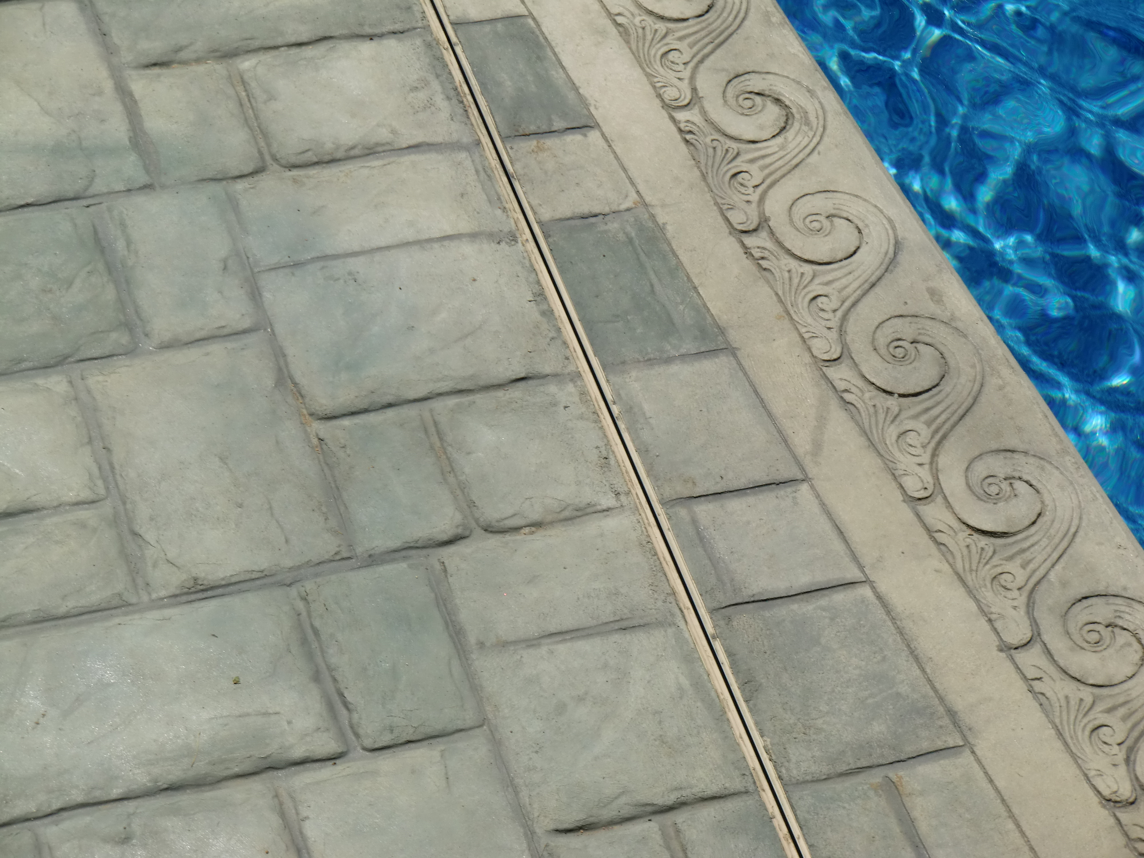 stamped concrete on a swimming pool