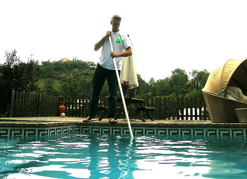 cleaning a swimming pool in Indianapolis